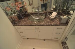 marble bathroom vanity top and vessel bowl sink make this renovation unique