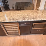 beverage center is a key feature in this kitchen remodel